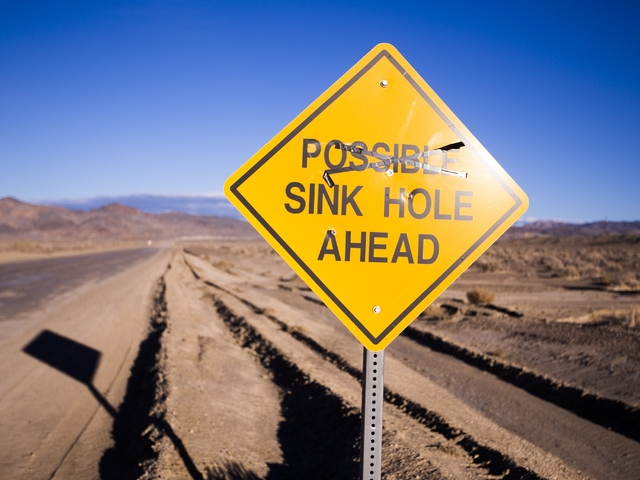 A sign warns drivers on the Silver Peak Road is seen Friday, Nov. 21,2015.  Silver Peak, the only operating lithium mine in the United States, has been operational since the 1960's. (Jeff Scheid/L ...