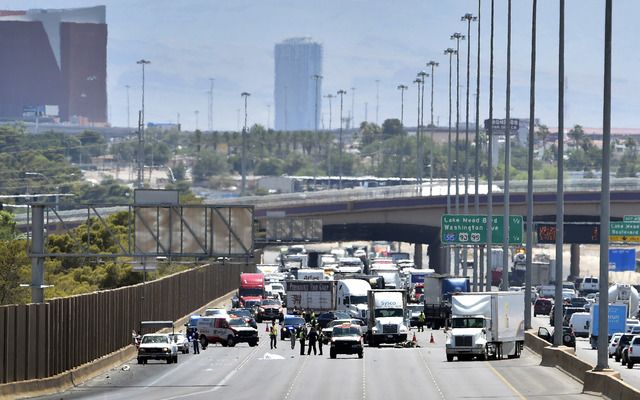 Las Vegas police investigate a fatal crash involving a motorcycle on northbound Interstate 15 just south of Cheyenne Avenue on June 23, 2015. (David Becker/Las Vegas Review-Journal)