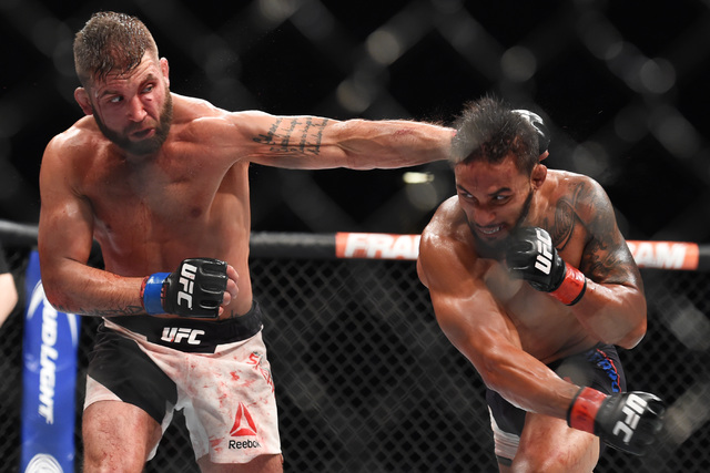 Jeremy Stephens, left, and Dennis Bermudez trade punches during their fight at UFC 189 Saturday, July 11, 2015 at the MGM Grand Garden Arena in Las Vegas, Nevada. (Sam Morris/Las Vegas News Bureau)