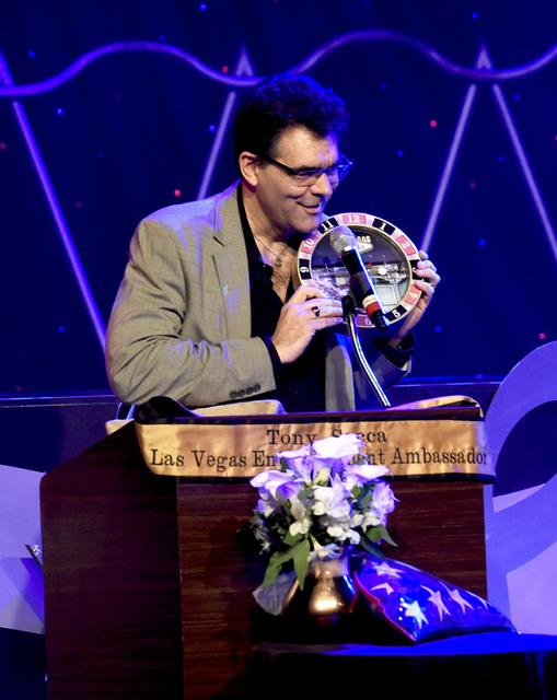 Las Vegas Review-Journal entertainment columnist John Katsilometes shows off one of his cherished momentos, a Tony Sacca Las Vegas roulette wheel singing clock, at the Tony Sacca Celebration of Li ...