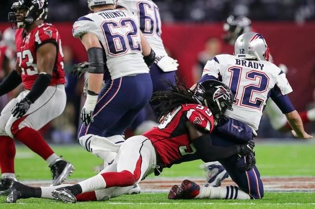Feb 5, 2017; Houston, TX, USA; Atlanta Falcons outside linebacker De'Vondre Campbell (59) sacks New England Patriots quarterback Tom Brady (12) during the second quarter during Super Bowl LI at NR ...