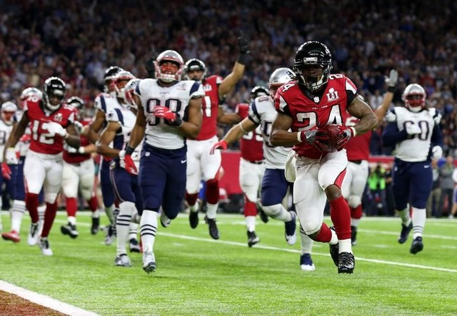 Feb 5, 2017; Houston, TX, USA; Atlanta Falcons running back Devonta Freeman (24) scores a touchdown during the second quarter against the New England Patriots during Super Bowl LI at NRG Stadium.  ...
