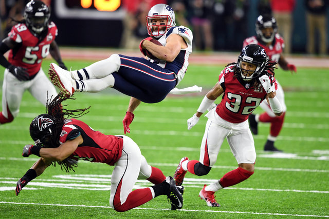Feb 5, 2017; Houston, TX, USA; New England Patriots wide receiver Julian Edelman (11) is brought down by Atlanta Falcons cornerback Jalen Collins (32) in the first quarter during Super Bowl LI at  ...