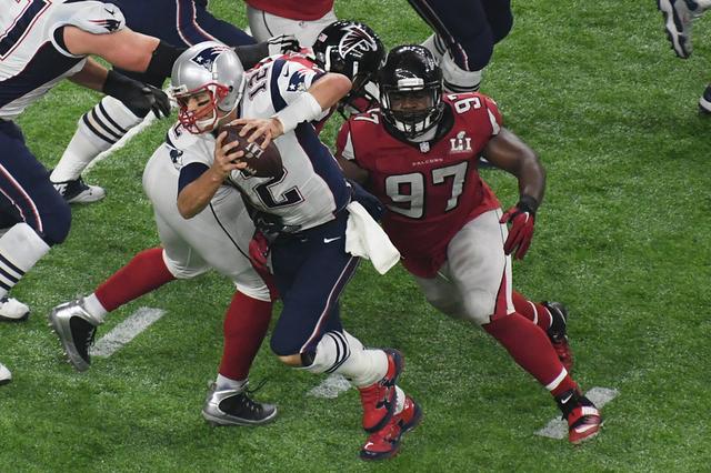 Feb 5, 2017; Houston, TX, USA; New England Patriots quarterback Tom Brady (12) is sacked by Atlanta Falcons defensive tackle Grady Jarrett (97) in the fourth quarter during Super Bowl LI at NRG St ...