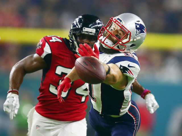Feb 5, 2017; Houston, TX, USA; New England Patriots wide receiver Julian Edelman (11) cannot catch a pass against Atlanta Falcons cornerback Brian Poole (34) in the fourth quarter during Super Bow ...