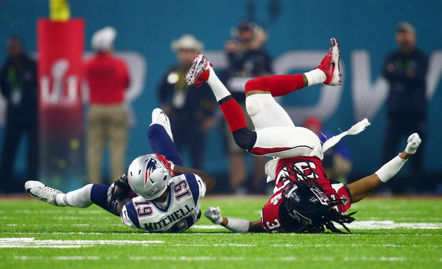 Feb 5, 2017; Houston, TX, USA; New England Patriots wide receiver Malcolm Mitchell (19) is tackled by Atlanta Falcons cornerback Jalen Collins (32) in the fourth quarter during Super Bowl LI at NR ...