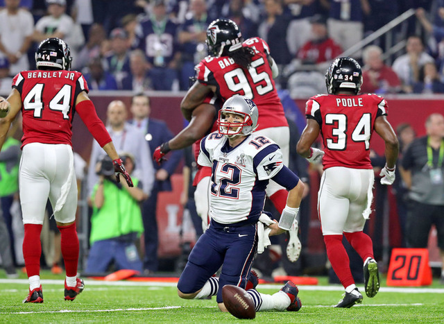 Feb 5, 2017; Houston, TX, USA; New England Patriots quarterback Tom Brady (12) reacts after being sacked during the fourth quarter against the Atlanta Falcons during Super Bowl LI at NRG Stadium.  ...