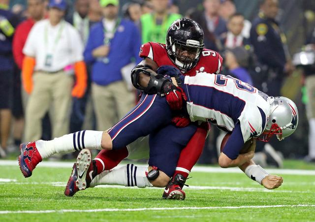 Feb 5, 2017; Houston, TX, USA; Atlanta Falcons defensive tackle Grady Jarrett (97) sacks New England Patriots quarterback Tom Brady (12) during the fourth quarter during Super Bowl LI at NRG Stadi ...