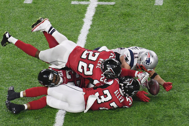 Feb 5, 2017; Houston, TX, USA; New England Patriots wide receiver Julian Edelman (11) catches a tipped pass just off the turf against the Atlanta Falcons in the fourth quarter during Super Bowl LI ...
