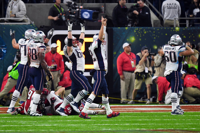 Feb 5, 2017; Houston, TX, USA; New England Patriots quarterback Tom Brady (12) and his team celebrate their win over Atlanta Falcons in overtime during Super Bowl LI at NRG Stadium. The Patriots w ...