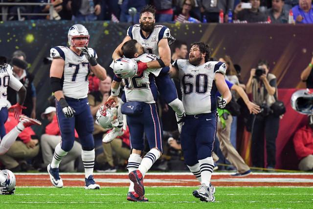 Feb 5, 2017; Houston, TX, USA; New England Patriots quarterback Tom Brady (12) and wide receiver Julian Edelman (11) celebrate their win over Atlanta Falcons during Super Bowl LI at NRG Stadium. T ...