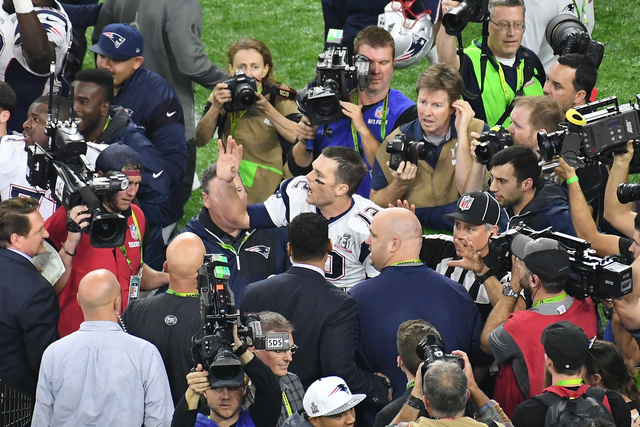 Feb 5, 2017; Houston, TX, USA; New England Patriots quarterback Tom Brady (12) reacts after defeating the Atlanta Falcons in overtime during Super Bowl LI at NRG Stadium. Mandatory Credit: Richard ...