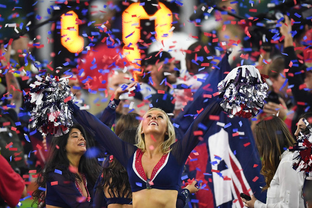 Feb 5, 2017; Houston, TX, USA; New England Patriots cheerleader celebrates in the confetti after the win over Atlanta Falcons during Super Bowl LI at NRG Stadium. The Patriots won 34-28. Mandatory ...