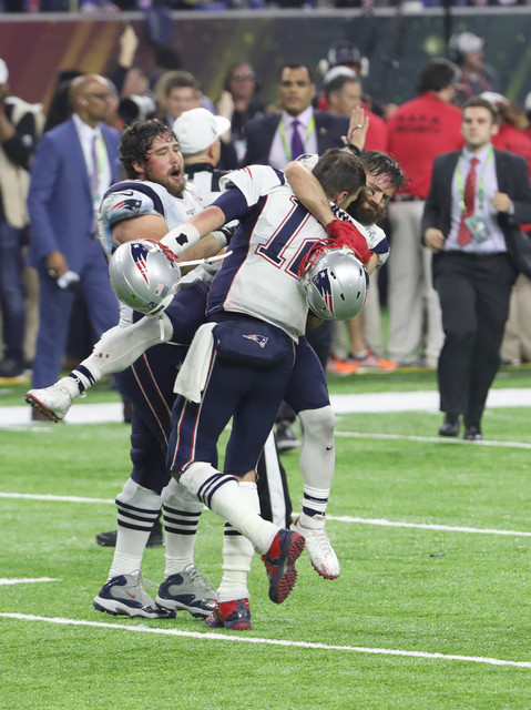 Feb 5, 2017; Houston, TX, USA; New England Patriots wide receiver Julian Edelman (11) and Tom Brady (12) celebrate after winning Super Bowl LI in overtime over the Atlanta Falcons 34-28 at NRG Sta ...