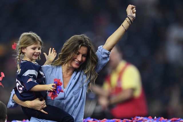 Feb 5, 2017; Houston, TX, USA; Gisele Bundchen and her daughter Vivian Brady celebrate after the game between the Atlanta Falcons and the New England Patriots during Super Bowl LI at NRG Stadium.  ...