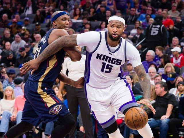Feb 12, 2017; Sacramento, CA, USA; Sacramento Kings forward DeMarcus Cousins (15) drives around New Orleans Pelicans forward Dante Cunningham (33) during the fourth quarter at Golden 1 Center. The ...