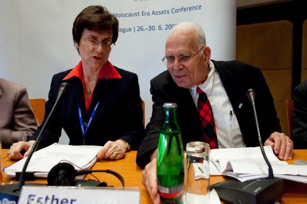 Esther Finder, right, speaks in 2009 at the Holocaust Era Assets Conference in Prague. (Courtesy)