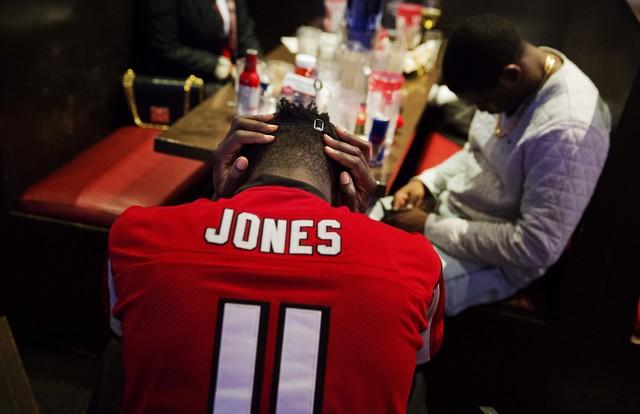 Atlanta Falcons fan CJ Scott hangs his head in his hands at Taco Mac restaurant in Atlanta after watching on television the New England Patriots beat Atlanta in Super Bowl LI in Houston, Sunday, F ...