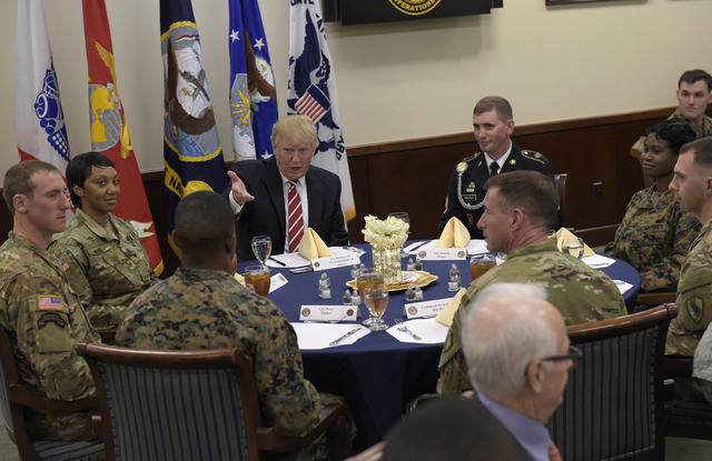 President Donald Trump has lunch with troops while visiting U.S. Central Command and U.S. Special Operations Command at MacDill Air Force Base, Fla., Monday, Feb. 6, 2017. Trump, who spent the wee ...