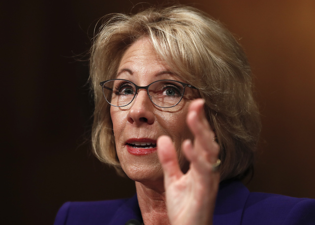 Education Secretary-designate Betsy DeVos testifies on Capitol Hill in Washington at her confirmation hearing before the Senate Health, Education, Labor and Pensions Committee, Jan. 17, 2017. (Car ...