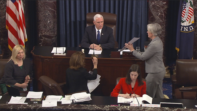 Vice President Mike Pence presides over the Senate in Washington, Tuesday, Feb. 7, 2017, during the Senate's vote on Education Secretary-designate Betsy DeVos. The Senate confirmed DeVos with Penc ...