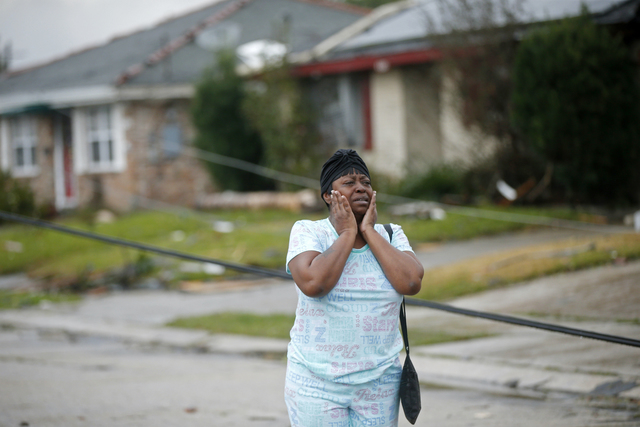 Lisa Carruth reacts as she surveys the damage after a tornado tore through the eastern part of New Orleans, Tuesday, Feb. 7, 2017. (Gerald Herbert/AP)
