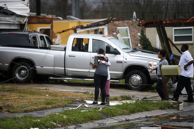People hug after a tornado tore through the eastern part of New Orleans, Tuesday, Feb. 7, 2017. (Gerald Herbert/AP)