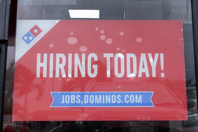 In this Thursday, Oct. 27, 2016, photo, a Domino's hiring sign on the main entrance is displayed in Hialeah, Fla. (Alan Diaz/AP)