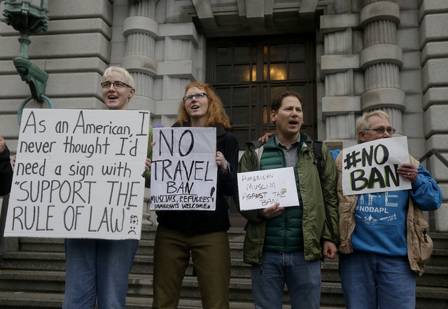 Kay Aull, from left, holds a sign and chants with Beth Kohn, Paul Paz y Mino and Karen Shore outside of the 9th U.S. Circuit Court of Appeals in San Francisco, Tuesday, Feb. 7, 2017. President Don ...