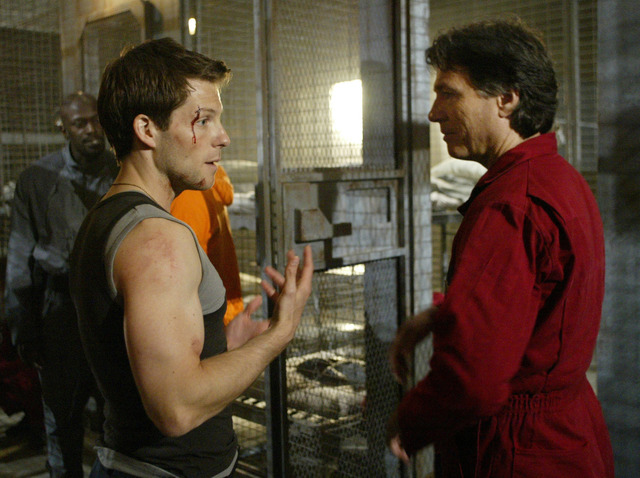 "In this May 19, 2004 file photo, actors Jamie Bamber, left, and Richard Hatch talk in between takes during the filming of Sci-fi channel's ""Battlestar Galactica,"" in Surrey, British Columbia. Hatc ..."