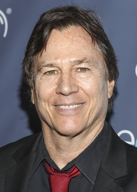 "In this Aug. 18, 2013 file photo, actor Richard Hatch arrives at the 2013 Geekie Awards at the Avalon in Los Angeles. Hatch, perhaps best known for playing Captain Apollo in the original ""Battlest ..."