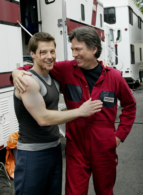 In this May 19, 2004 file photo, actors Jamie Bamber, left, and Richard Hatch share a laugh outside their trailers while waiting to be called on to the set during the filming of the Sci-fi channel ...