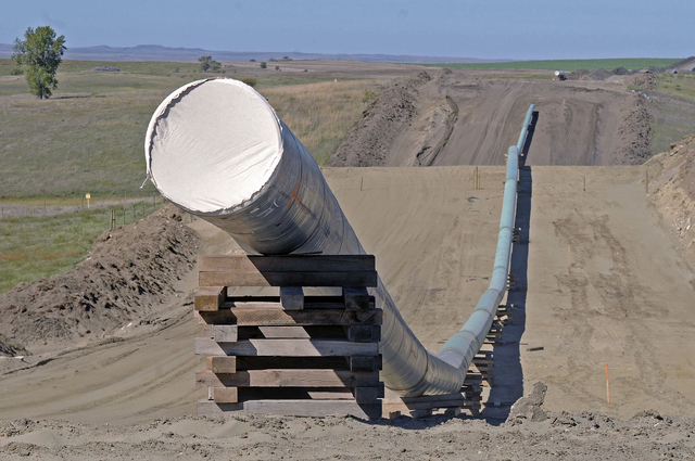 This Sept. 29, 2016, file photo, shows a section of the Dakota Access Pipeline under construction near the town of St. Anthony in Morton County, North Dakota. (Tom Stromme/The Bismarck Tribune via AP)