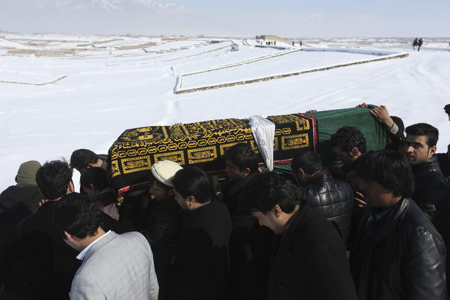 Men carry the coffin of a relative who died in a suicide attack on the Supreme Court in Kabul, Afghanistan, Wednesday, Feb. 8, 2017. A suicide bomber on Tuesday targeted the Supreme Court building ...