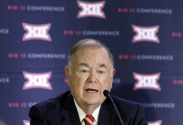 University of Oklahoma President David Boren, the Big 12 Conference Board of Directors chairman, speaks to reporters after the second day of the Big 12 sports conference meetings in Irving, Texas, ...