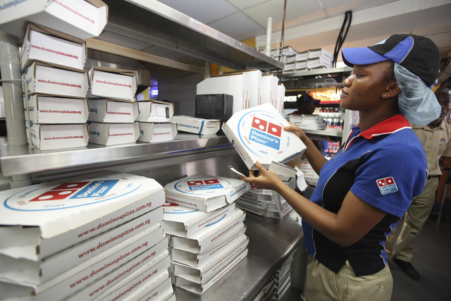 A worker prepares boxes at a Domino's pizza restaurant in Lagos, Nigeria. (Sunday Alamba/AP, File)