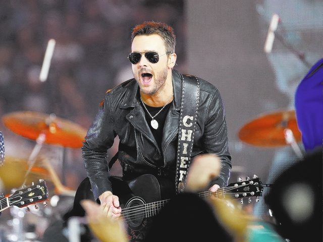 Eric Church performs at halftime during an NFL game between The Washington Redskins and Dallas Cowboys on Thursday, Nov. 24, 2016, in Arlington, Texas. (Ron Jenkins/AP)