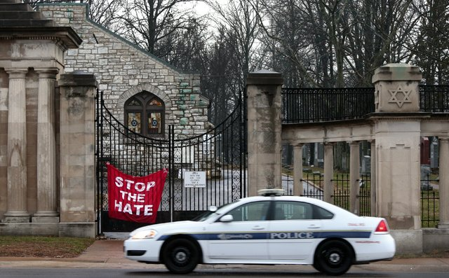 A University City police car patrols in front of Chesed Shel Emeth Cemetery in University City, Mo., on Tuesday, Feb. 21, 2017. Authorities in Missouri are investigating after dozens of headstones ...