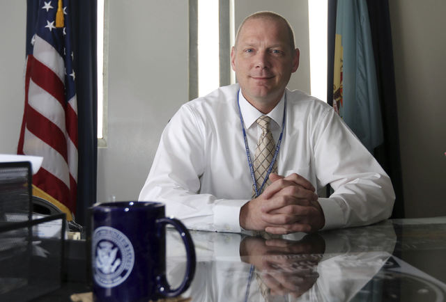 Warden for James T. Vaughn Correctional Center, poses for a photo in his office in Smyrna, Del. Department of Correction officials said Monday, Feb. 20, 2017, that Pierce has been placed on paid l ...