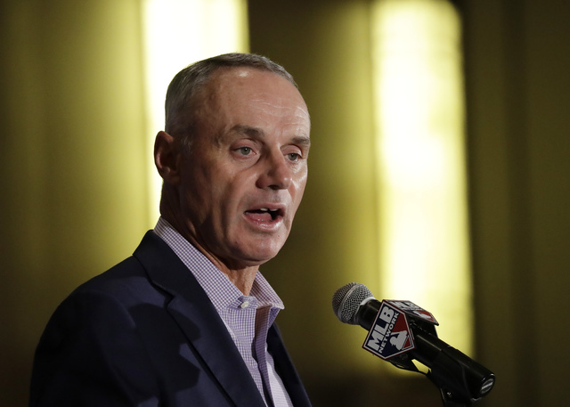 Major League Baseball Commissioner Rob Manfred answers questions at a news conference Tuesday, Feb. 21, 2017, in Phoenix. (Morry Gash/AP)