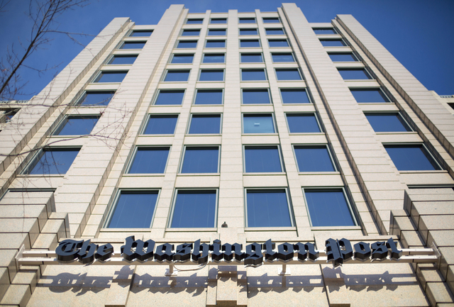 """In this Dec. 11, 2015 file photo, the One Franklin Square Building in Washington, that houses the Washington Post newspaper.  The Washington Post is featuring a new motto on the paper's website: """" ..."""