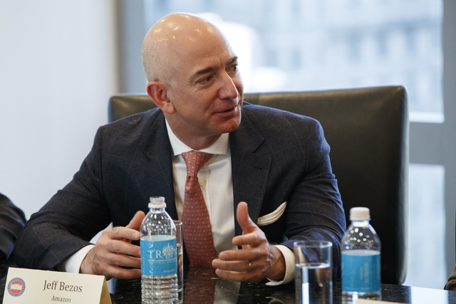In this Dec. 14, 2016 file photo, Amazon founder and CEO  Jeff Bezos, speaks during a meeting with then-President-elect Donald Trump and technology industry leaders at Trump Tower in New York.  Th ...