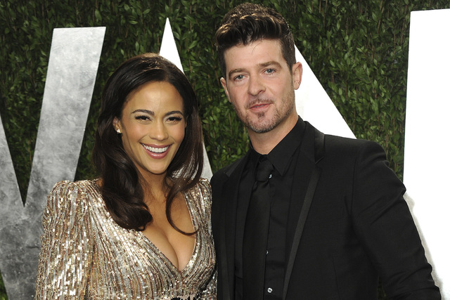 Paula Patton and Robin Thicke arrive at the 2013 Vanity Fair Oscars Viewing and After Party at the Sunset Plaza Hotel in West Hollywood, Calif. (Jordan Strauss/Invision/AP, File)