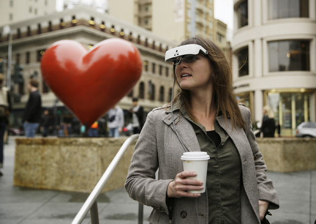In this photo taken Thursday, Feb. 2, 2017, Yvonne Felix wears eSight electronic glasses and looks around Union Square during a visit to San Francisco. The glasses enable the legally blind to see. ...
