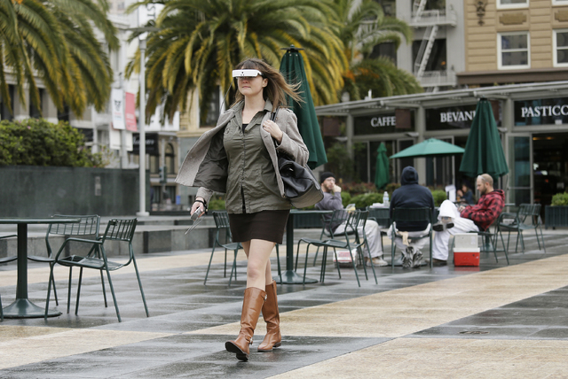 In this photo taken Thursday, Feb. 2, 2017, Yvonne Felix, of Canada, wears eSight electronic glasses and walks through Union Square during a visit to San Francisco. The glasses enable the legally  ...