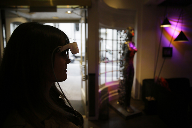 In this photo taken Thursday, Feb. 2, 2017, Yvonne Felix wears eSight electronic glasses and looks around the lobby of the Hotel Zeppelin during a visit to San Francisco. The glasses enable the le ...