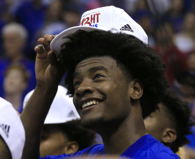 Kansas guard Josh Jackson dons his Big 12 championship hat following the team's NCAA college basketball game against TCU in Lawrence, Kan., Wednesday, Feb. 22, 2017. Kansas defeated TCU 87-68. The ...