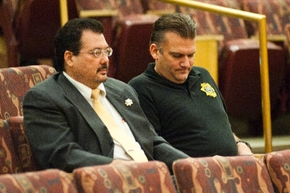 Las Vegas Township Constable John Bonaventura, left, sits with Jason Watkins, COO of the Las Vegas Township constable's office, during a meeting of the Clark County Commission in Las Vegas on Aug. ...