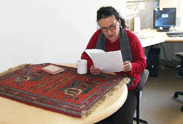 Moniru Ravanipour works in her office at the Black Mountain Institute at the University of Nevada, Las Vegas, during her time in the City of Asylum program in 2007. (Courtesy)