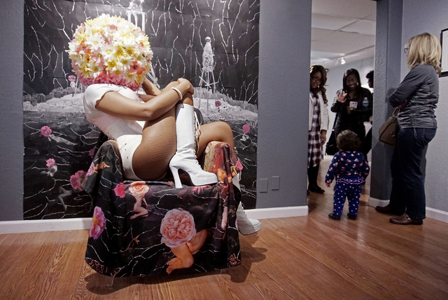 A performer poses as part of artist JK Russ's performance art piece during an opening reception for A Room of One's Own at Left of Center Gallery Saturday. (Sarah Corsa/Las Vegas Review-Journal)
